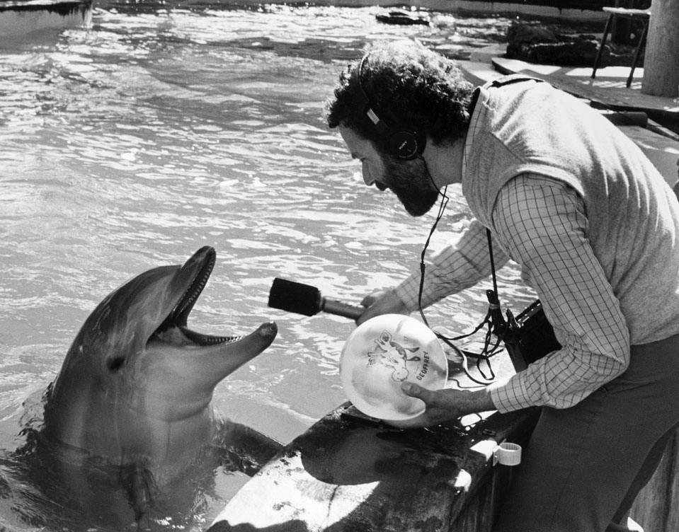 this is the caption for jim metzner and dolphin at seaworld