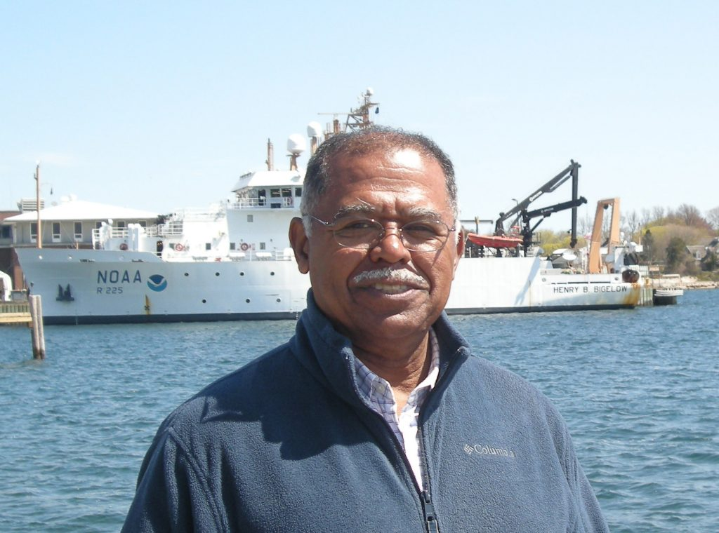 Ambrose Jearld Jr., with the NOAA Ship Henry B. Bigelow in the background. Photo credit: NOAA Fisheries/Shelley Dawicki, NEFSC