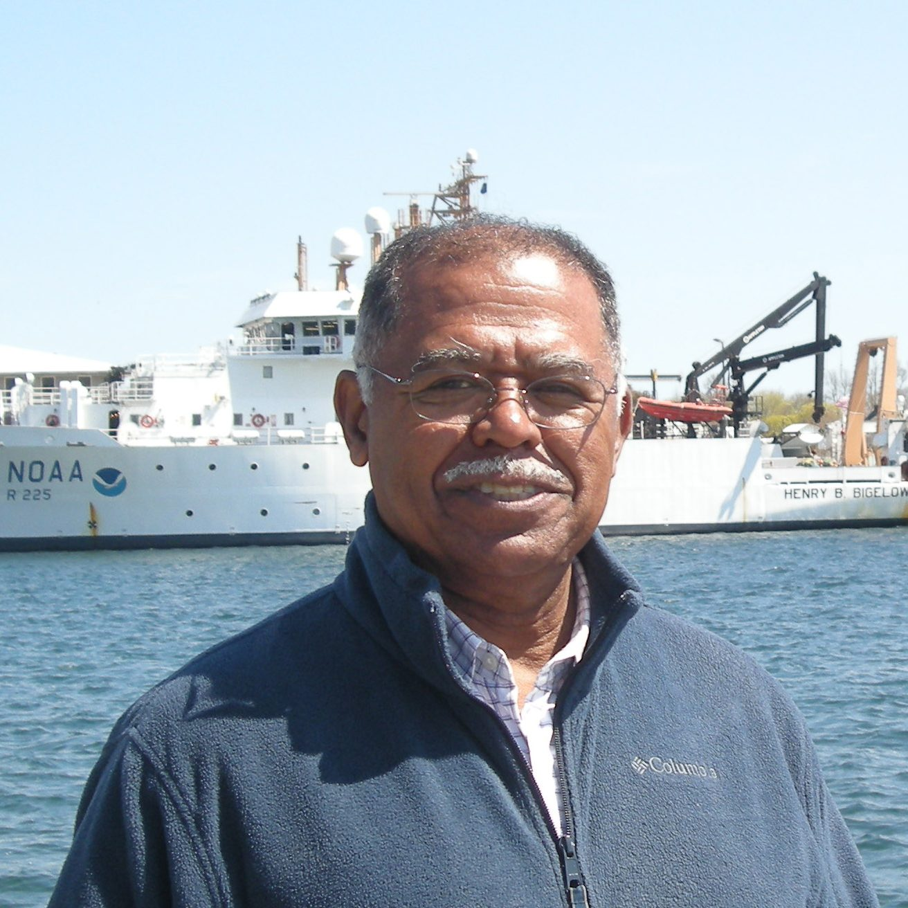 Ambrose Jearld Jr., with the NOAA Ship Henry B. Bigelow in the background. Photo credit: NOAA Fisheries/Shelley Dawicki, NEFSC